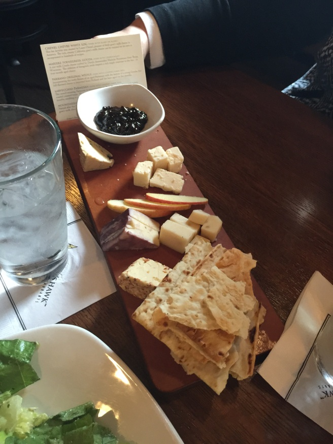 artisanal cheese plate with a plum sauce